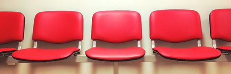 Row of red seats in a waiting room