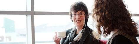 Dr Kirsty Boyd enjoys cup of tea with a colleague