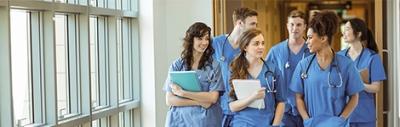 Doctors in training walking down corridor